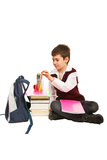 Student boy  prepare for homework. Student boy choice a pencil and prepare to make homework and sitting on the floor Royalty Free Stock Images