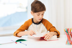 Student boy reading book or textbook at home Royalty Free Stock Image