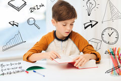 Student boy reading book or textbook at home Stock Photos