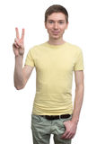 Student boy showing victory sign. Successful young student boy showing victory sign, isolated on white background Royalty Free Stock Photography