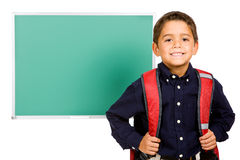 Student: Boy Standing In Front of Blank Chalkboard Royalty Free Stock Photos