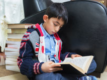 Student boy studying on books Stock Image