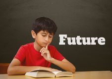 Student boy at table reading against grey blackboard with future text. Digital composite of Student boy at table reading against grey blackboard with future text Stock Images