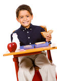 Student: Boy Takes a Bite from Sandwich royalty free stock image