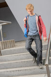 Student boy walking down university stairs Royalty Free Stock Photos