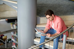 Student boy or young man reading book at library Royalty Free Stock Photos