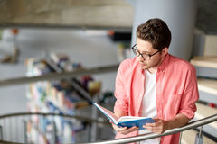Student boy or young man reading book at library Stock Images