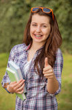 Student with braces showing thumb up outside Royalty Free Stock Photography
