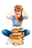 Student with bulging eyes reading book Royalty Free Stock Photography