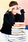 Student and bunch of books Royalty Free Stock Image