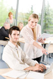 Student businesspeople having meeting in office. Discussing project royalty free stock photo