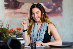 Student or businesswoman working in cafe Royalty Free Stock Photo