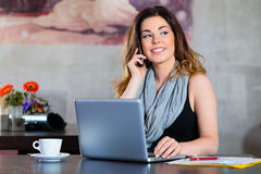 Student or businesswoman working in cafe Royalty Free Stock Photography