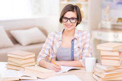 Student is busy studying at the desk Stock Image