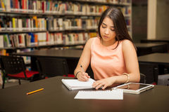 Student busy with work Royalty Free Stock Image