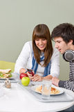Student cafeteria - teenage couple Royalty Free Stock Photography