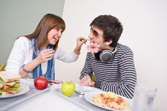 Student cafeteria - teenage couple having fun Royalty Free Stock Images
