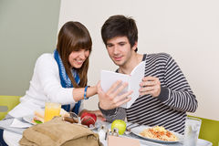 Student cafeteria - Teenagers having lunch break stock images