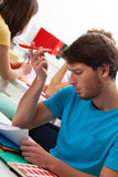 Student can't solve task. Handsome male student can't solve difficult task Royalty Free Stock Photos