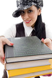 Student in cap holding stack of books Stock Images