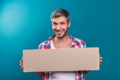 Student cardboard copy space. Smiling laughing happy man holding cardboard Stock Photo