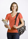 Student carrying backpack and books Royalty Free Stock Photo