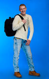 Student carrying bag and books Stock Photography
