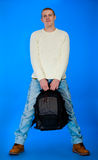 Student carrying bag and books in back Royalty Free Stock Photo