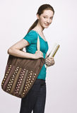 Student carrying book bag and notebook Stock Image