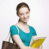 Student carrying book bag and notebook Stock Images