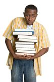 Student Carrying Books. African american student carrying books Royalty Free Stock Photos
