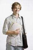 Student carrying books and briefcase Royalty Free Stock Photos