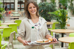 Student carrying food tray in the cafeteria Stock Photo