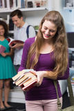 Student carrying small pile of books. At the college Royalty Free Stock Images