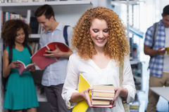 Student carrying small pile of books. At the college Stock Images