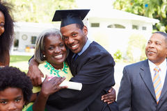 Student Celebrates Graduation With Parents Royalty Free Stock Images