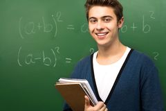 Student by Chalkboard Stock Image