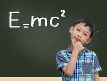 Student by chalkboard with e=mc2 Royalty Free Stock Image