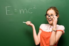 Student by chalkboard with e=mc2 Stock Photos