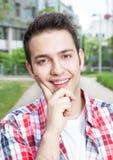 Student in a checked shirt looking at camera Royalty Free Stock Photos