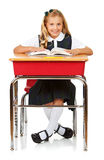 Student: Cheerful Schoolgirl Reading Book. Isolated on white series of a child in student uniform clothing Stock Image