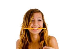 Student chewing pencil Royalty Free Stock Image
