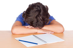 Student child asleep on his desk Stock Images