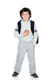 Student child with backpack and apple Royalty Free Stock Photography