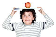 Student child with a book over his head Stock Photography