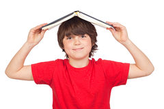 Student child with a book over his head Stock Photos