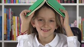Student Child Laughing in Library, School Girl Smiling at Camera, Education 4K.  stock footage