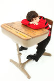 Student Child Sleeping Desk School. Adorable 7 year old boy in school clothes sleeping in desk over white background Stock Images