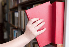 Student chooses book, close-up Stock Image