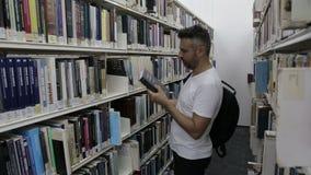 Student chooses books stock video